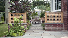 Brick walls and fencing on patio