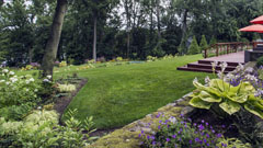 Brick walls, lawn and gardens