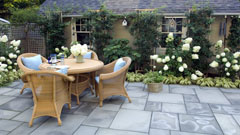 Outdoor seating and dining in small patio garden
