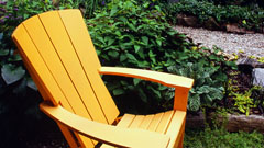 Adirondack chair within garden setting