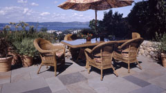 Patio with Hudson River views by Westover Landscape Design